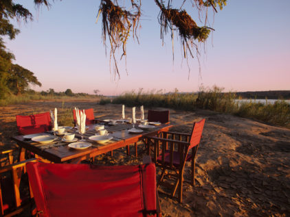 A river front dinner at Mandrare River Lodge