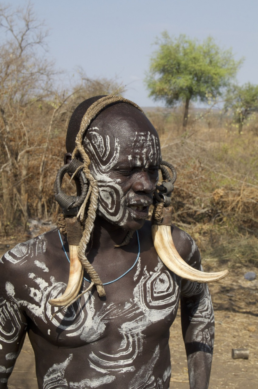 Mursi male with culturally appropriate body paint