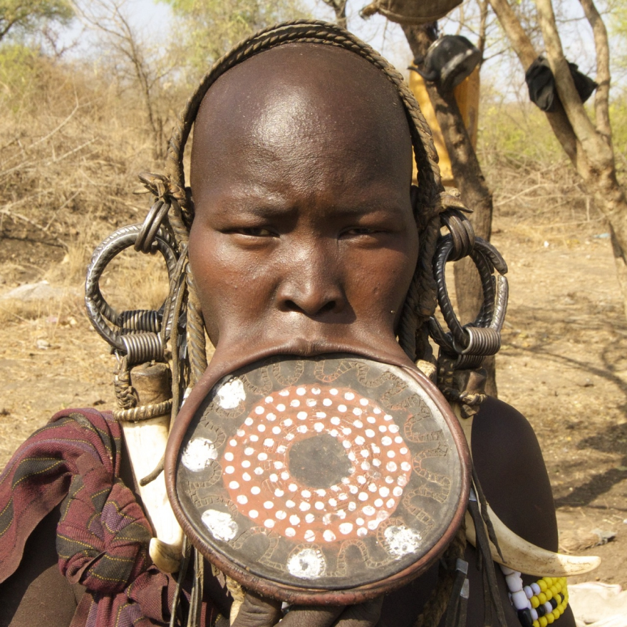 Mursi Woman with a disc in her mouth to show social standing