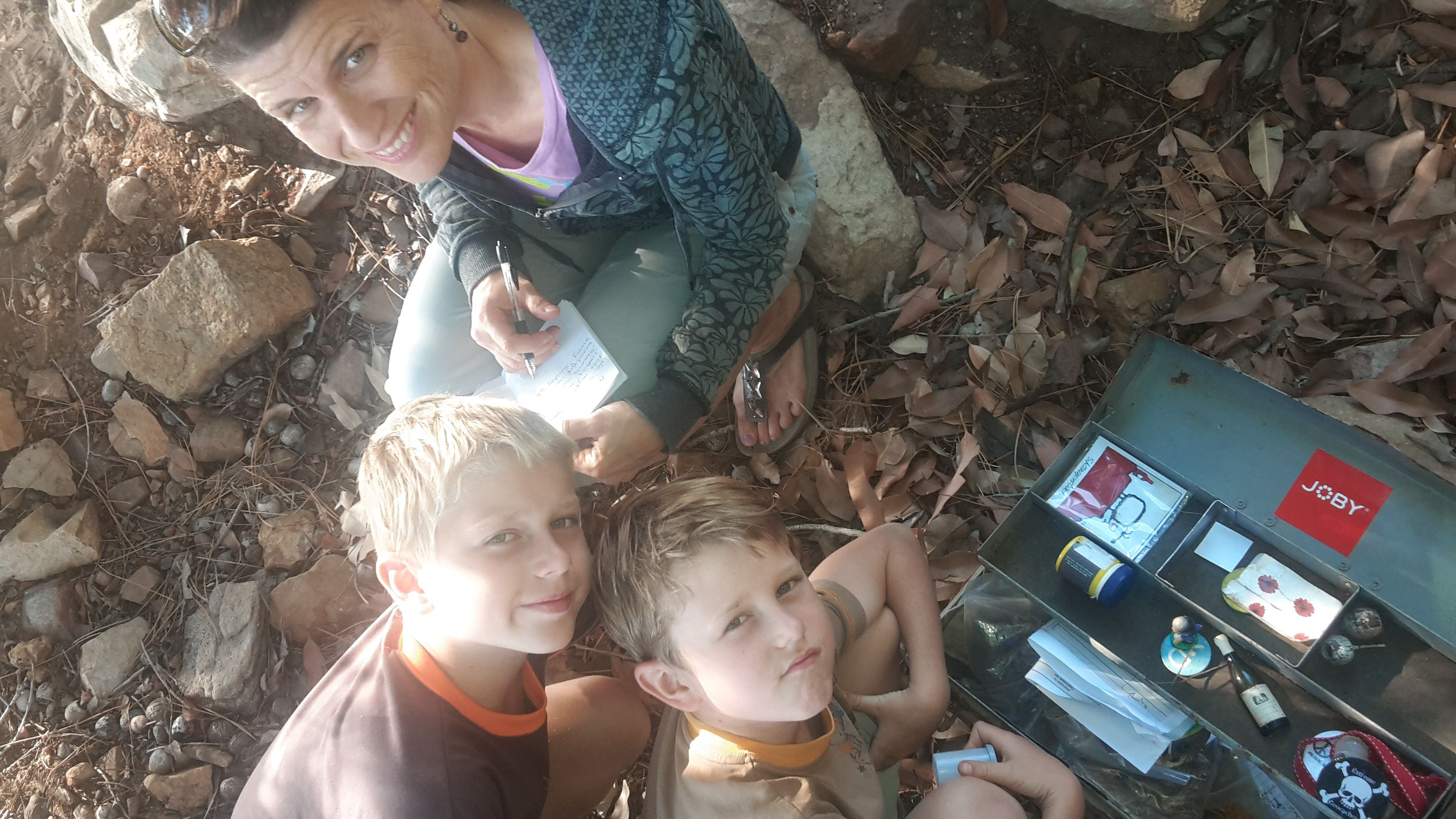Ross, Callum and Sandra Jenman find a Geo Caching site along the Pipe Track in Cape Town, South Africa, 2nd Image