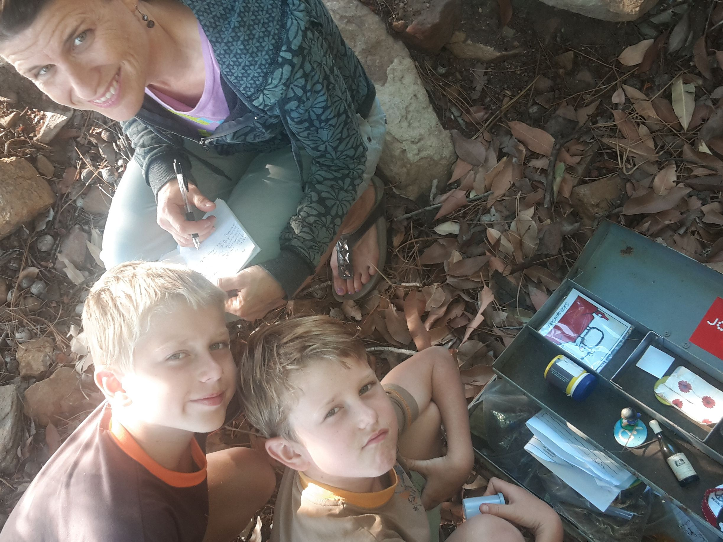 Ross, Callum and Sandra Jenman find a Geo Caching site along the Pipe Track in Cape Town, South Africa