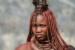 Himba Woman With Ornament On The Neck In The Village